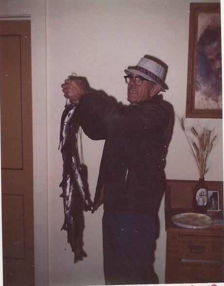 Dad holding fish in liv room
