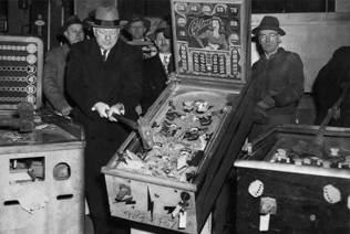 New York City Police Commissioner William O'Brien smashing a pinball machine in 1949